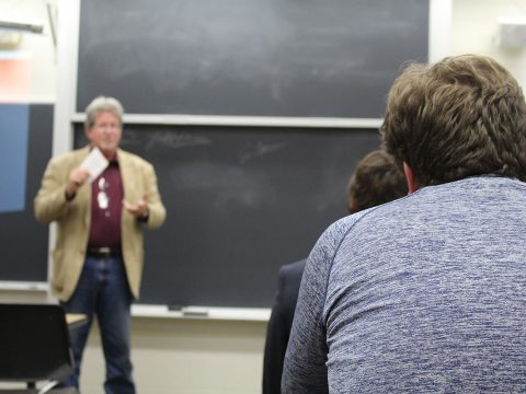 Students sit during a College Republicans meeting as Wisconsin State Assembly candidate Bill Ingram speaks.