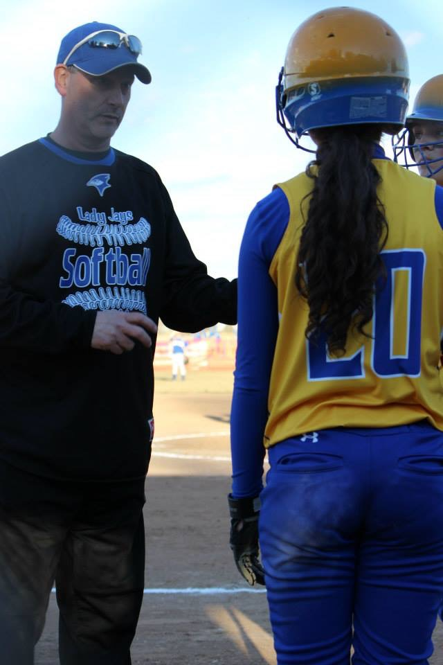 Dean Herman coaches second baseman, Kiana Gosh before she goes up to bat at the home game vs Waterloo.  ©2017 Alyssa Layton