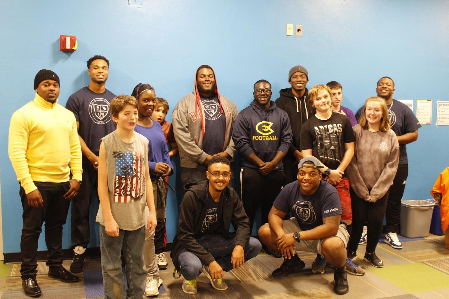 The Black Male Empowerment Group spends the night at the local Boys and Girls Club playing football and spending time with youth. Dennis Beale hopes the group will teach young African Americans skills for a better life.  © 2017 Allison Anhalt