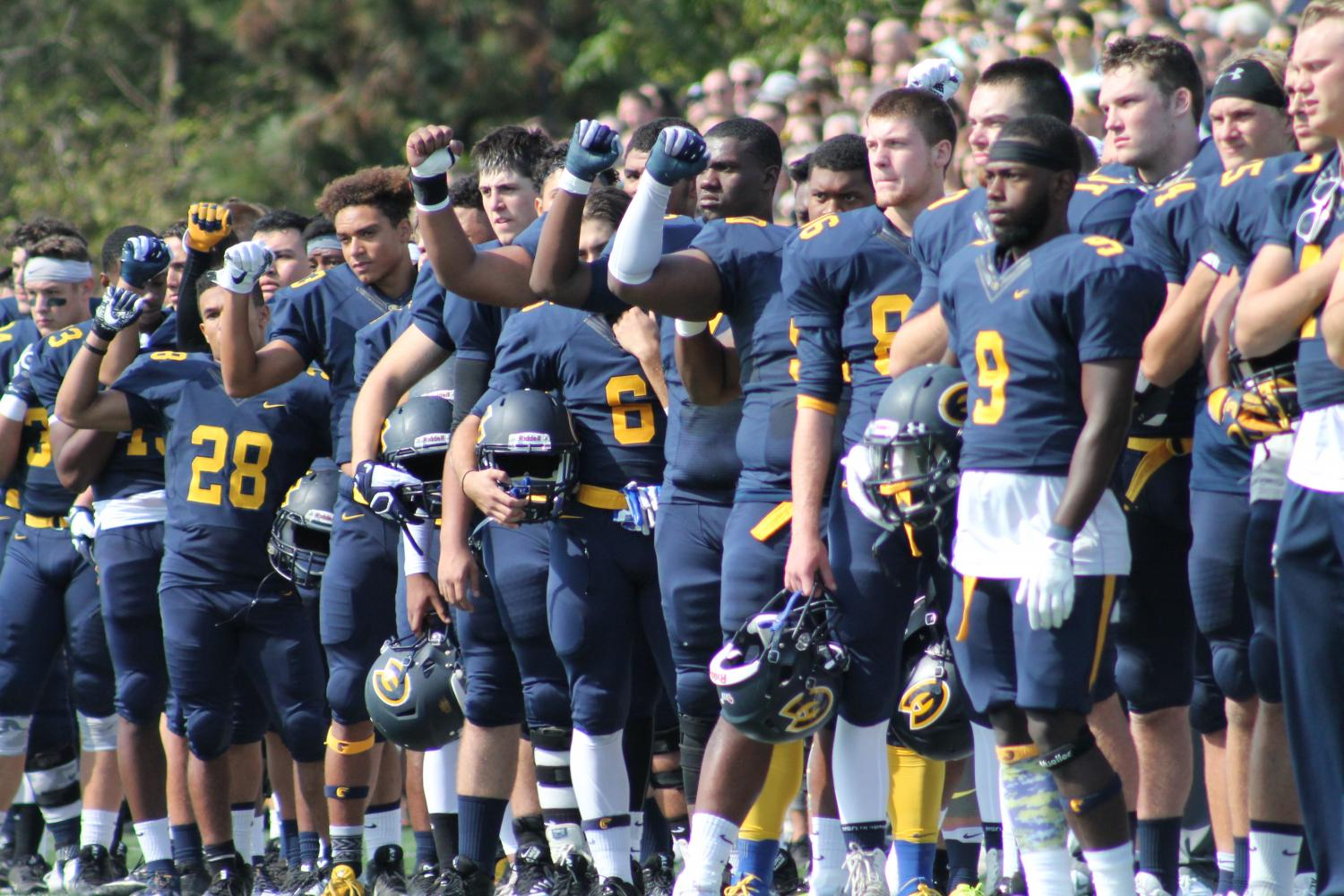 Blugold football players 'raise a fist' for injustice