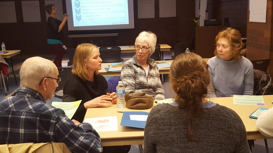 Elizabeth Giese, left, Director of the Eau Claire City-County Health Department, discussed health concerns with citizens of Eau Claire at the Community Conversation meeting. @ 2018 Sadie Sedlmayr