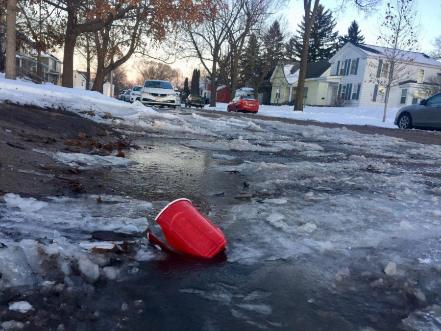 Cups, bottles and cans often litter the streets of Eau Claire's Randall Park neighborhood. The Randall Park neighborhood surrounds Historic Randall Park and comprises the housing just north of Water Street. ©2018 Samantha West