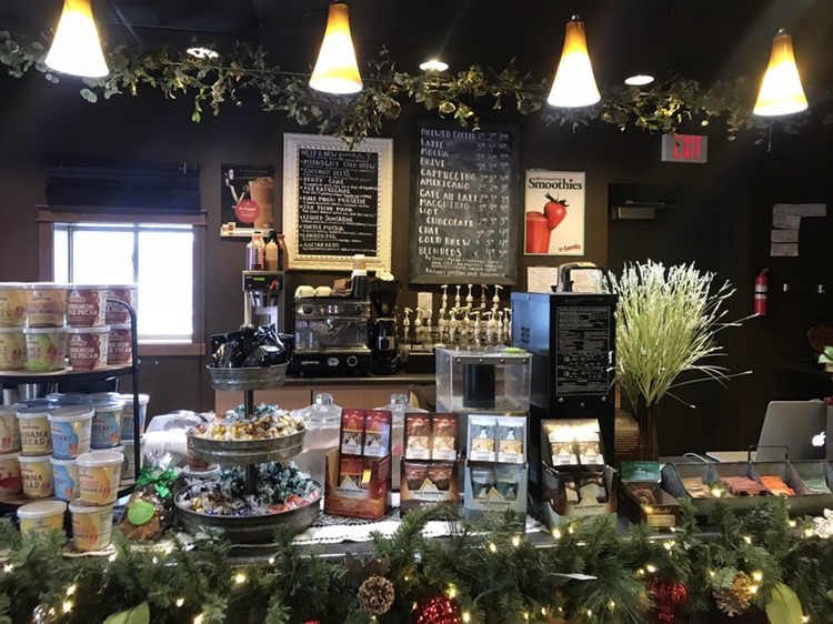 The Living Room Cafe menu displays their homemade treats and coffee among holiday decoration.