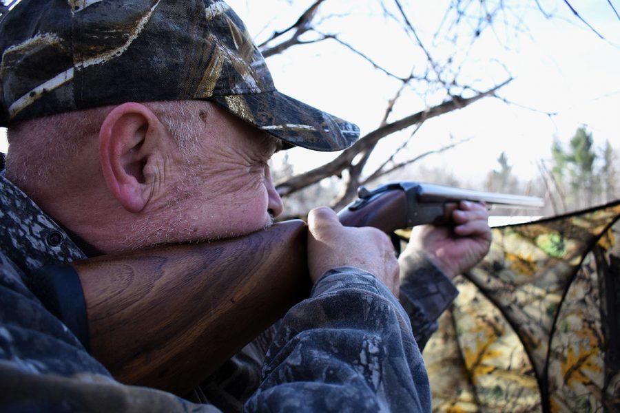 Hunter shooting during deer hunt