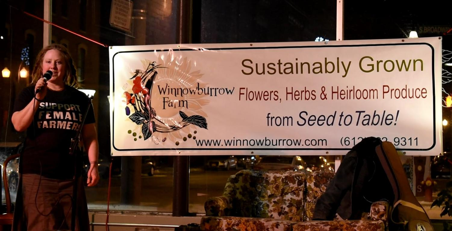 Photography by Rachel Helgeson / Bonnie Warndahl, owner of Winnowburrow Farm, speaks about the importance of local farms at Benefit for the Bounty in Menomonie.