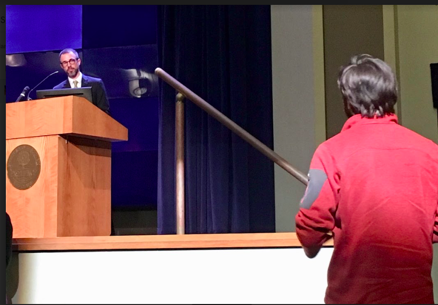 An+audience+member+asks+Barry+Burden+a+question+after+his+presentation+on+gerrymandering.+Burden+helped+co-found+the+Elections+Research+Center+at+the+University+of+Wisconsin-Madison.+