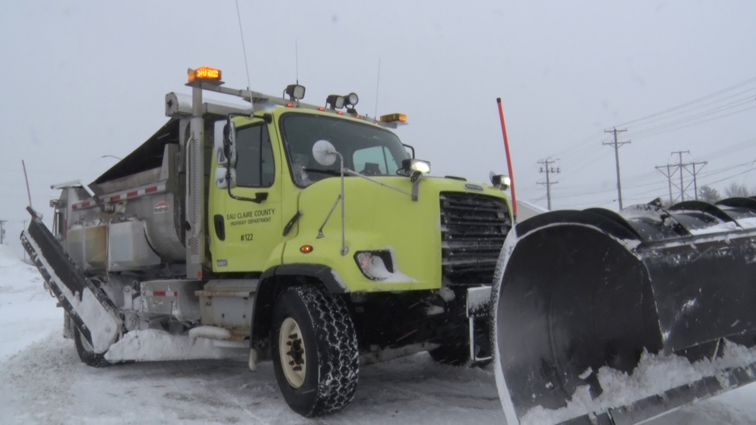 Eau Claire County Highway Department plow sets out to combat snowy roads.