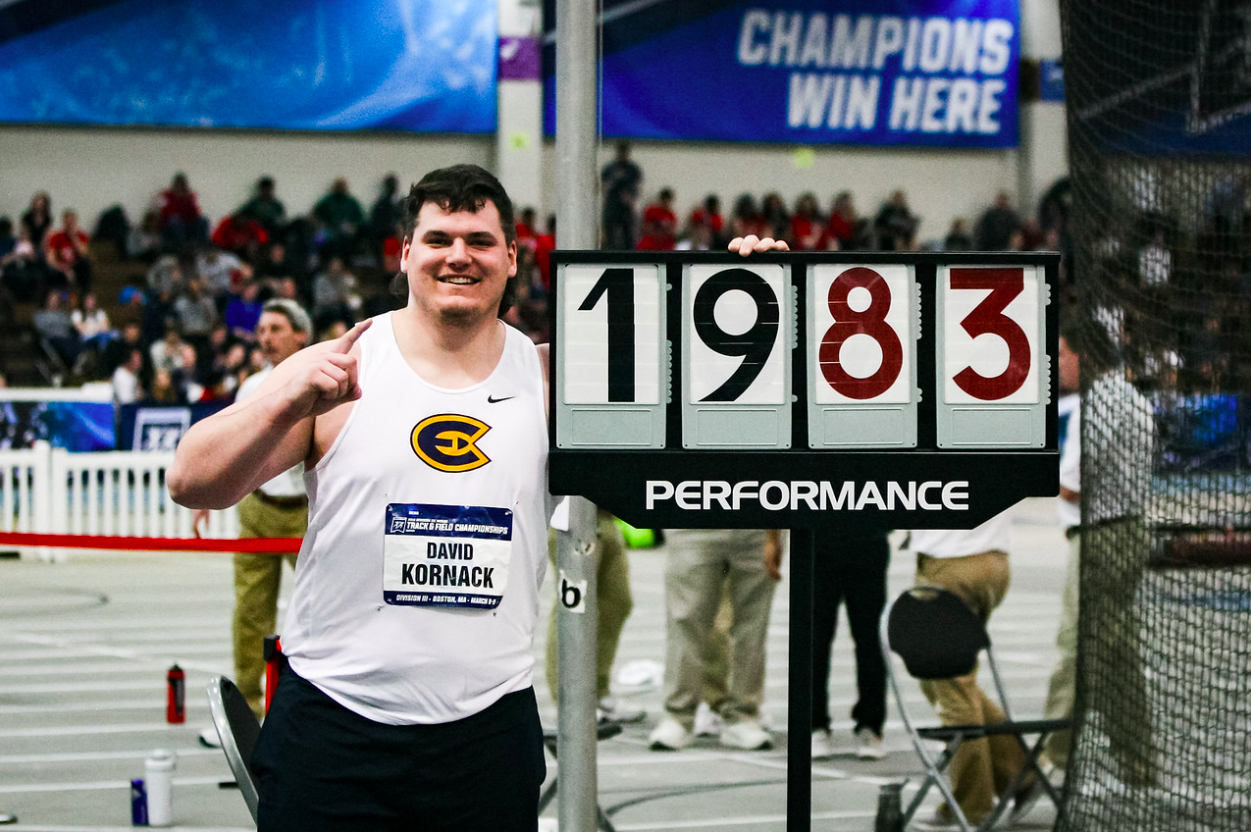 David Kornack shows off his record-breaking shotput results at NCAA Division III Track and Field Nationals.