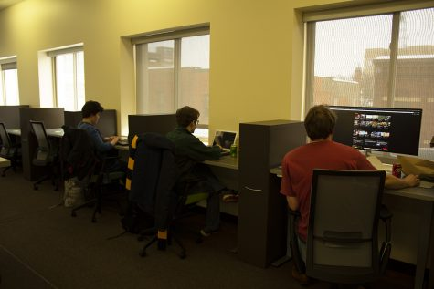 Clearwater Labs employees, including Alex Stout, co-founder and director and technical manager (far right), work in their new downtown office space at CoLAB, which is across from the Micon Downtown Cinema.
