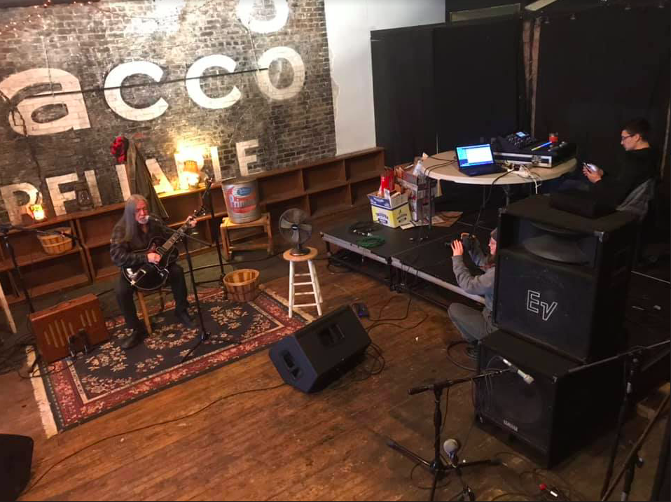 The music video set at The Venue in downtown Eau Claire was set against a brick wall, creating a warm environment.