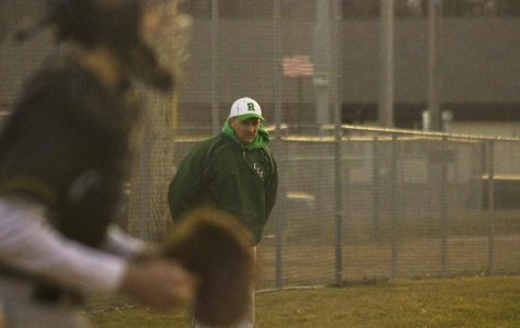Regis Head Coach Andy Niese coaching on the third base side during a game against Cadott. ©2019 Adam Pearson.