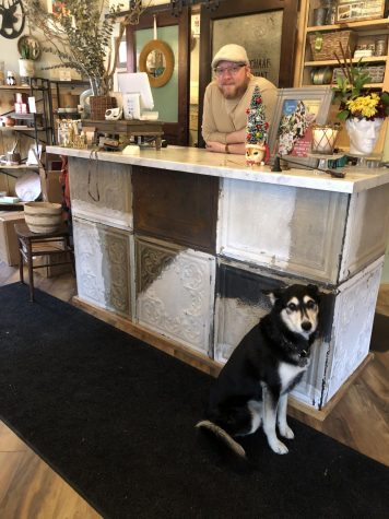 Matt Pabich works with his dog, Kaya, in his store, Raggedy Man.  © Olivia Bright 2019