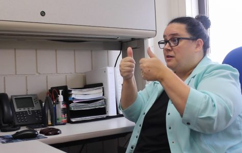 UW-Eau Claire American Sign Language professor Nicole Jones gives a student feedback by sending a video of herself signing. ©Kaitlyn Zenner 2019