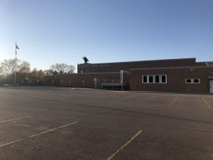 An empty parking lot outside Eau Claire Memorial High School sets the scene for the remainder of the academic school year, as schools remain closed under Gov. Tony Evers Safer-at-Home order. © Evan Hong 2020