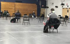 In Zorn Arena, students, faculty and staff wait to receive their COVID-19 test results in socially distanced chairs. ©Ta'Leah Van Sistine2021