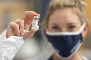 A nurse holds the Moderna COVID-19 vaccine. ©2021, University of Wisconsin-Eau Claire